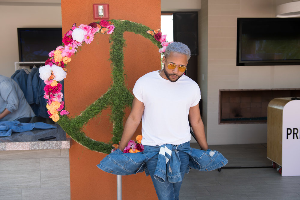Peek Inside Celebrity Pre-Coachella Gifting Suite floral peace sign PLT party.jpg