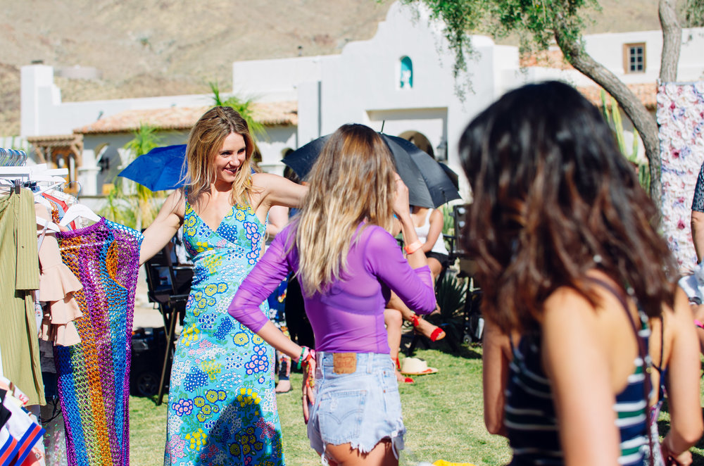 Ultimate Hollywood Coachella Poolside Party guests enjoying PLT gifting lounge.jpg