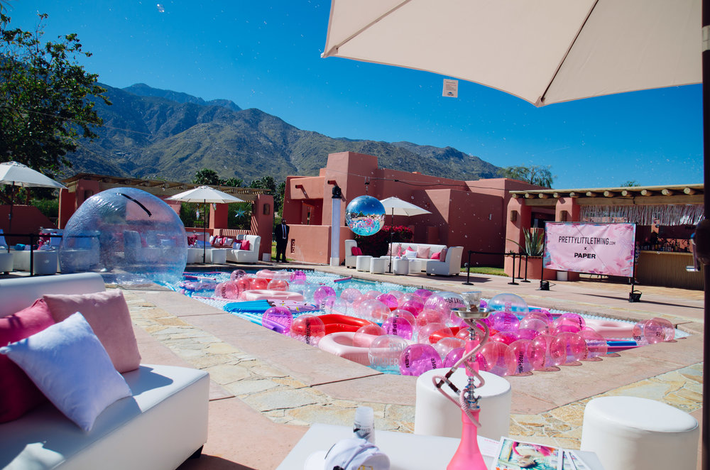 Ultimate Hollywood Coachella Poolside Party pink beach balls in the pool.jpg