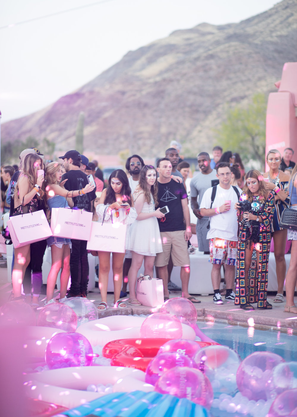 Ultimate Hollywood Coachella Poolside Party guests standing poolside.jpg
