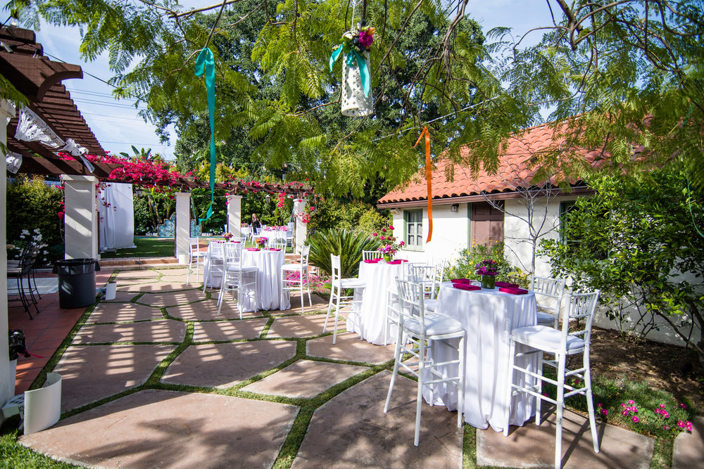 Vibrant Fiesta Backyard Wedding Reception intimate space with hanging lanterns in trees.jpg