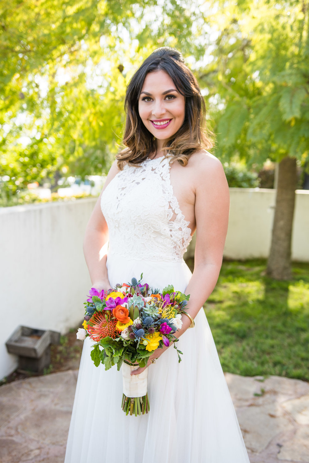 Vibrant Fiesta Backyard Wedding Reception beautiful bride and stunning spring bouquet.jpg