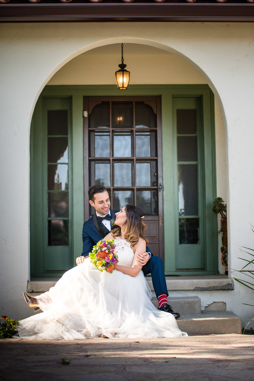 Vibrant Fiesta Backyard Wedding Reception bride and groom on steps of reception home.jpg