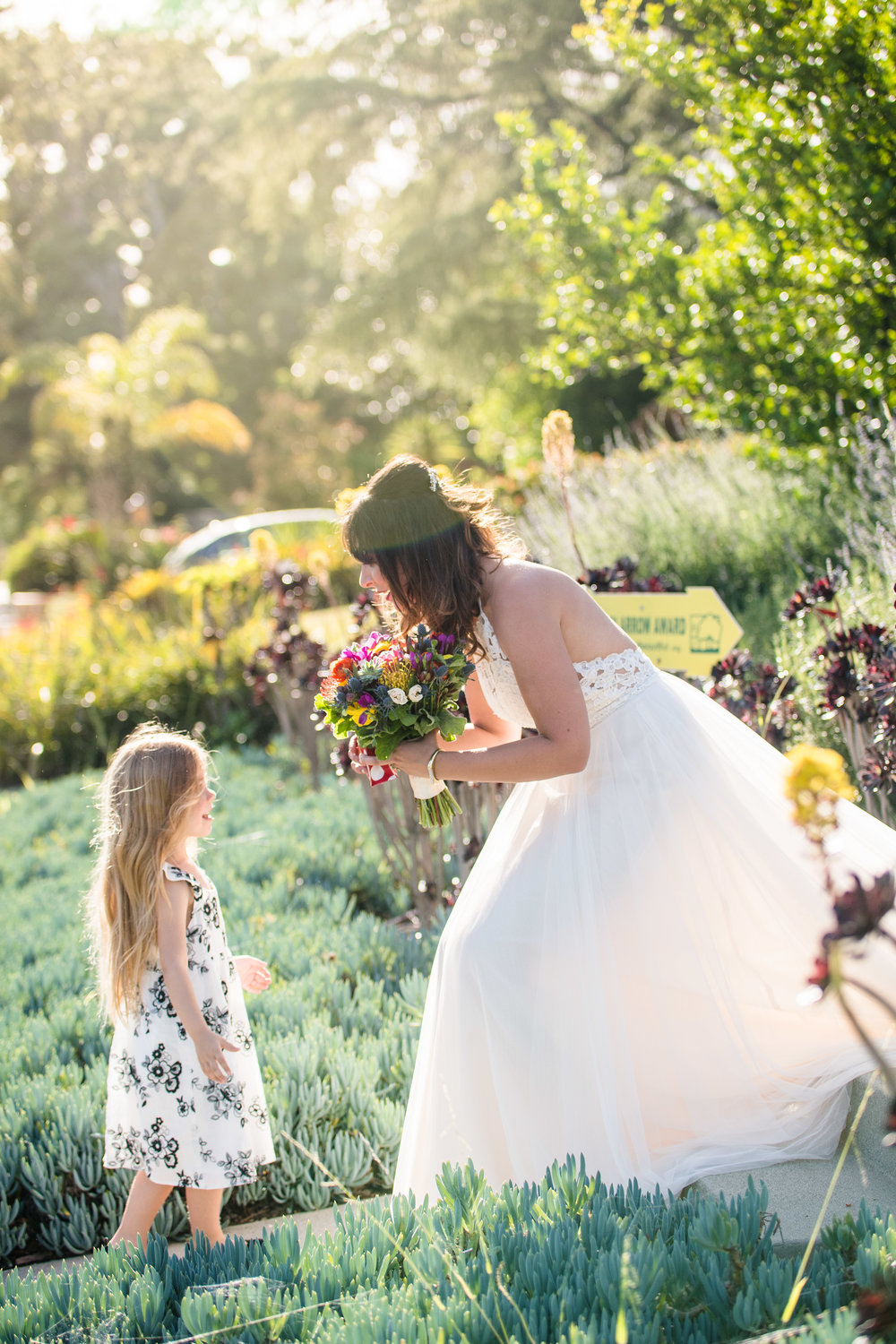 Vibrant Fiesta Backyard Wedding Reception bride with little guest.jpg