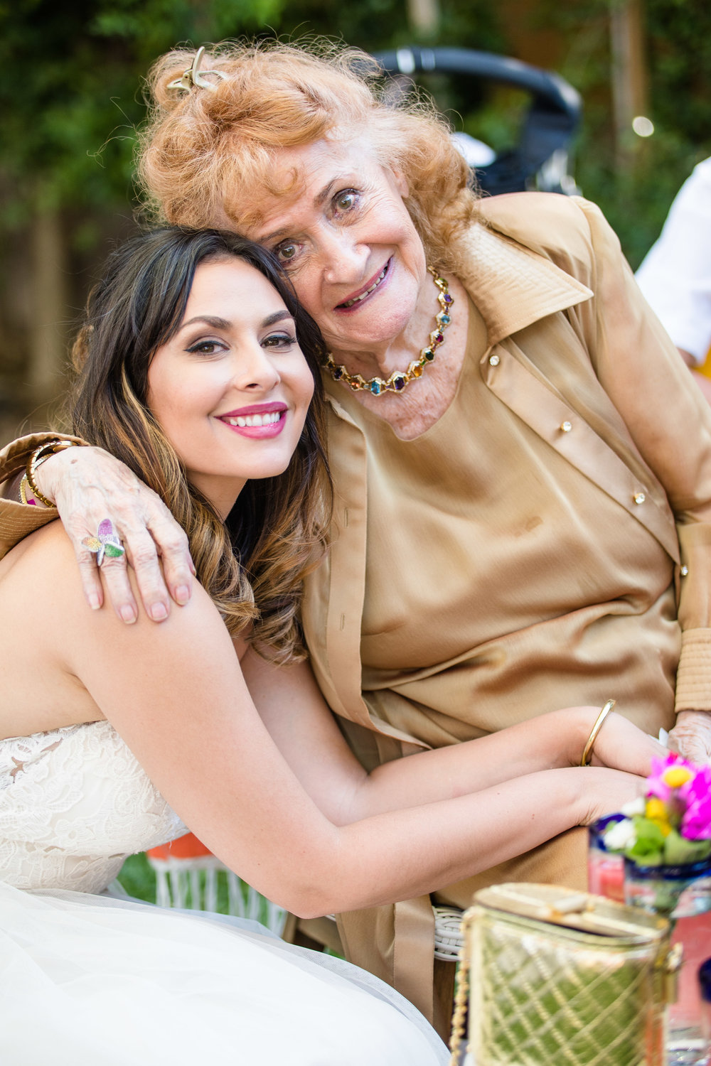 Vibrant Fiesta Backyard Wedding Reception bride and grandmother.jpg