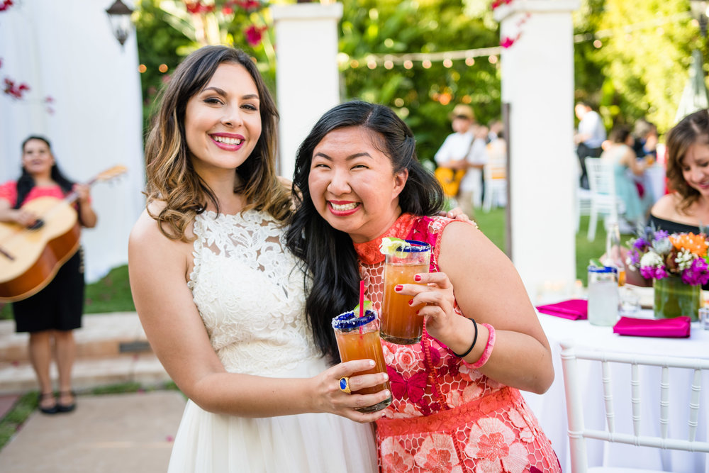 Vibrant Fiesta Backyard Wedding Reception bride and guest cheers.jpg