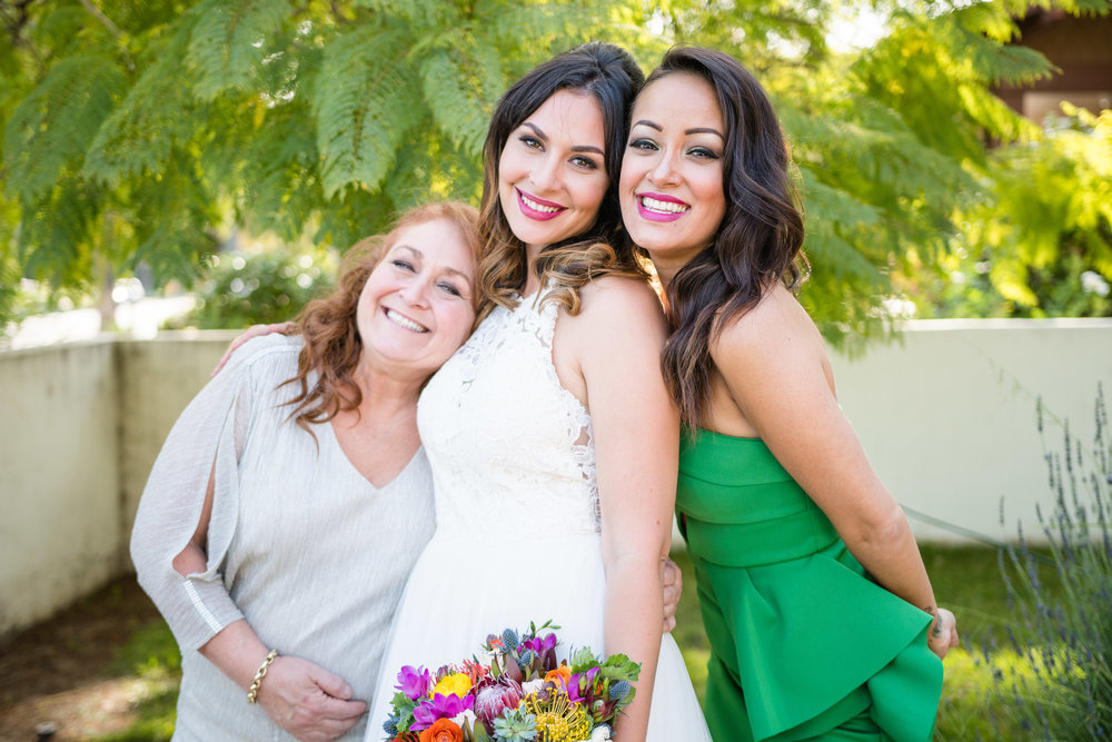 Vibrant Fiesta Backyard Wedding Reception bride mother and matron of honor.jpg