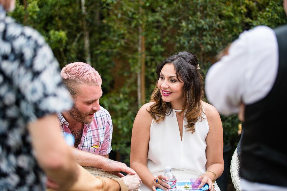 Vibrant Fiesta Backyard Wedding Reception bride enjoys meal with guests.jpg