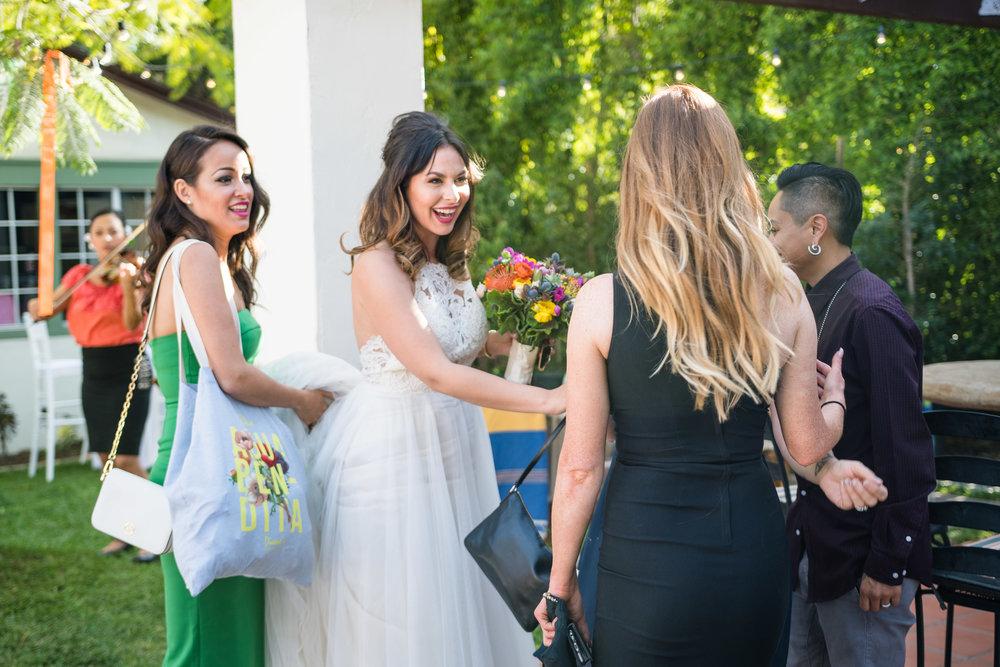 Vibrant Fiesta Backyard Wedding Reception bride welcoming guests.jpg