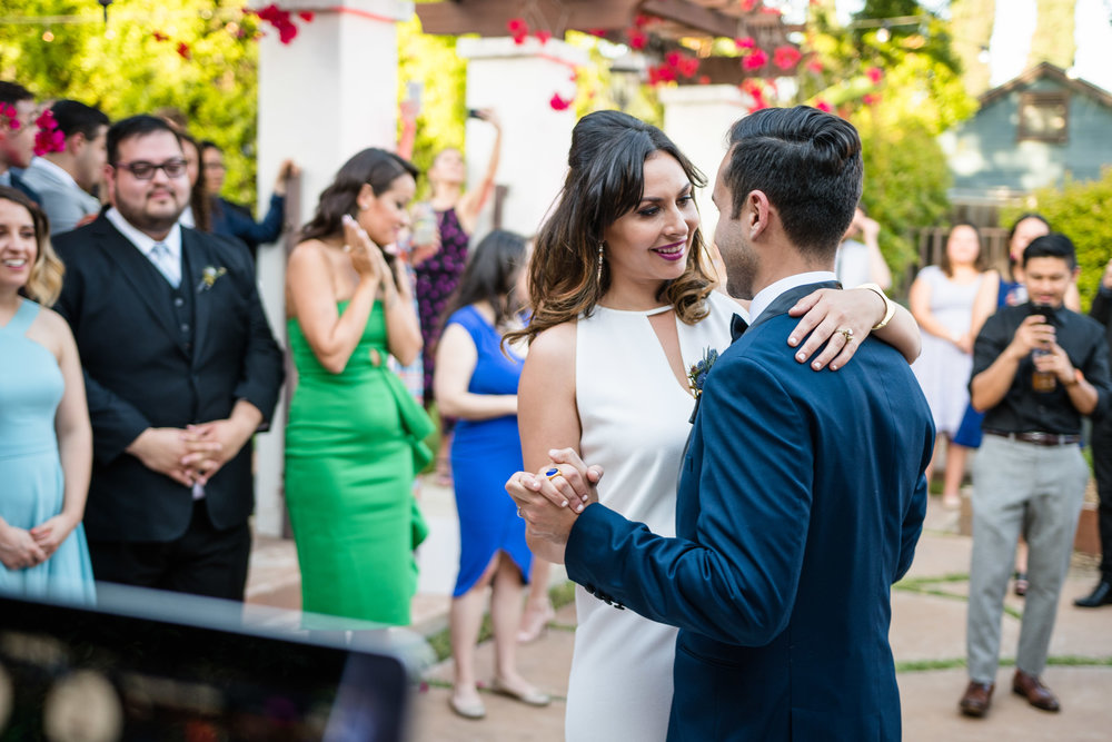 Vibrant Fiesta Backyard Wedding Reception bride and groom first dance.jpg