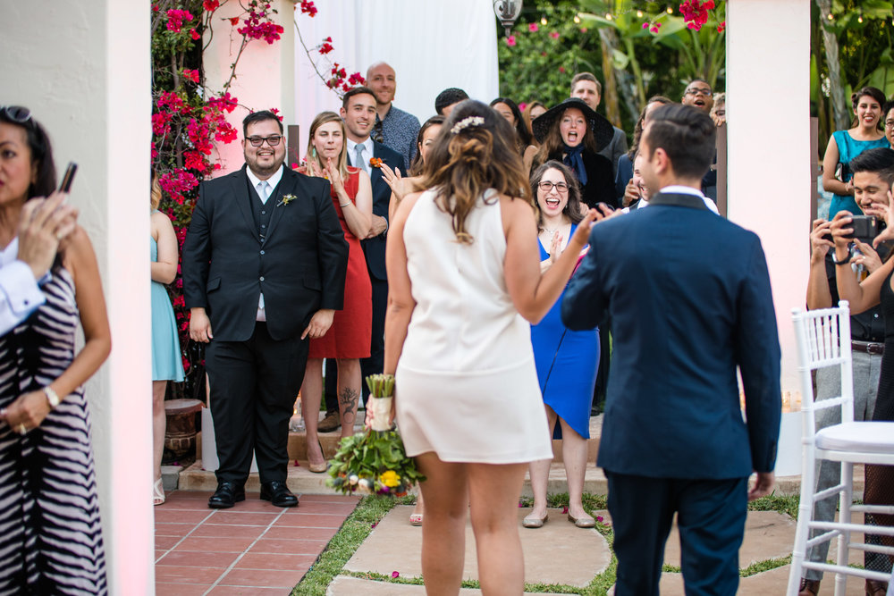 Vibrant Fiesta Backyard Wedding Reception family and friends greet bride and groom at reception.jpg