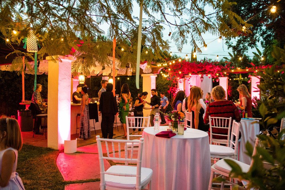 Vibrant Fiesta Backyard Wedding Reception twinkling lights deocrate backyard.jpg