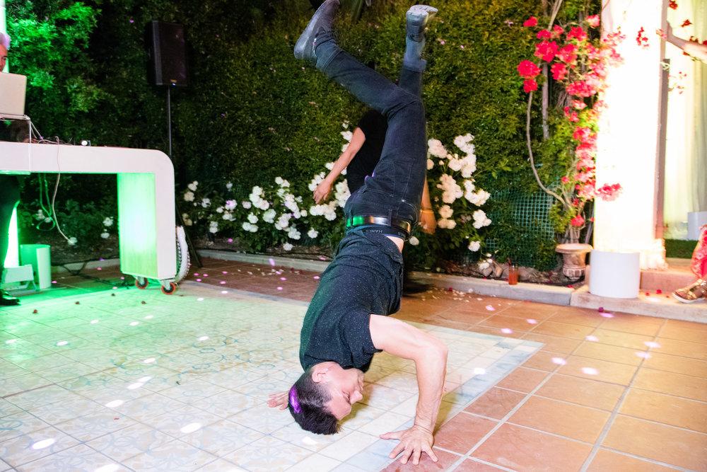 Vibrant Fiesta Backyard Wedding Reception break dancers.jpg