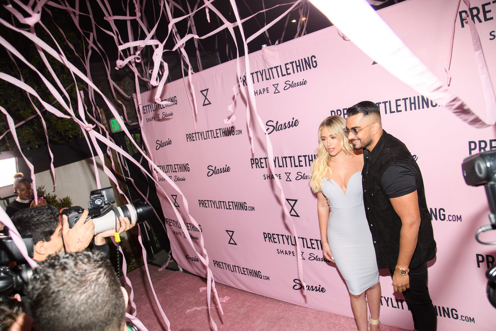 PrettyLittleThing New PLT Shape Collection with Stassie Celebrity Launch Party Stassiebaby and Umar Kamani with pink streamers raining down.jpg