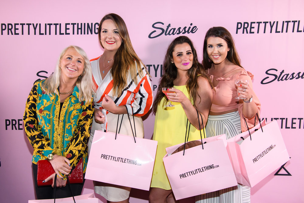 PrettyLittleThing New PLT Shape Collection with Stassie Celebrity Launch Party happy ladies with drinks and shopping bags.jpg