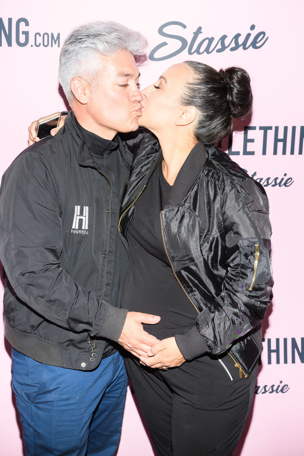 PrettyLittleThing New PLT Shape Collection with Stassie Celebrity Launch Party Herick Serna and Lori of WOTP together enjoy a kiss.jpg