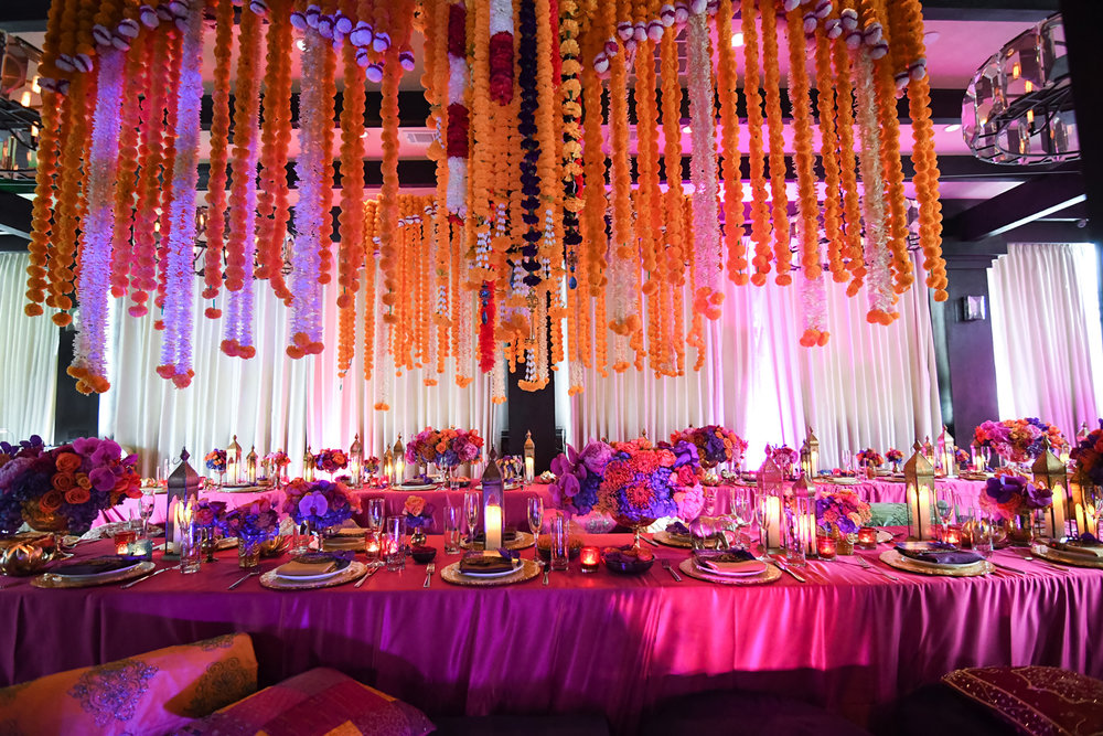 Moroccan Inspired Baby Shower Party hanging florals and pink lights made the room look majestic.jpg