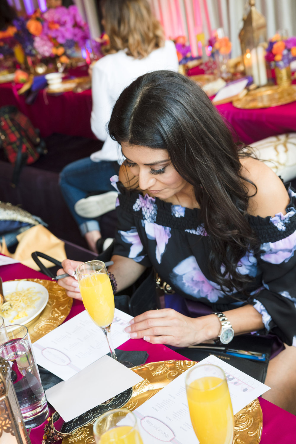 Moroccan Inspired Baby Shower Party guests playing whats in your purse.jpg