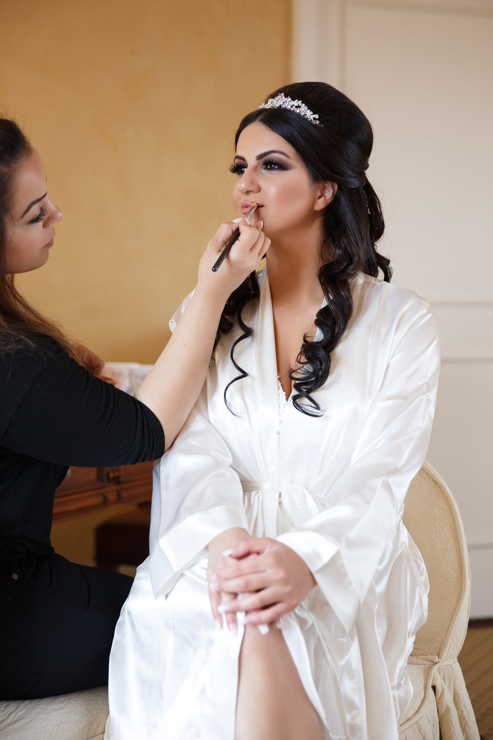 Elegant Pasadena Wedding to Make You Swoon bride getting her makeup done.jpg