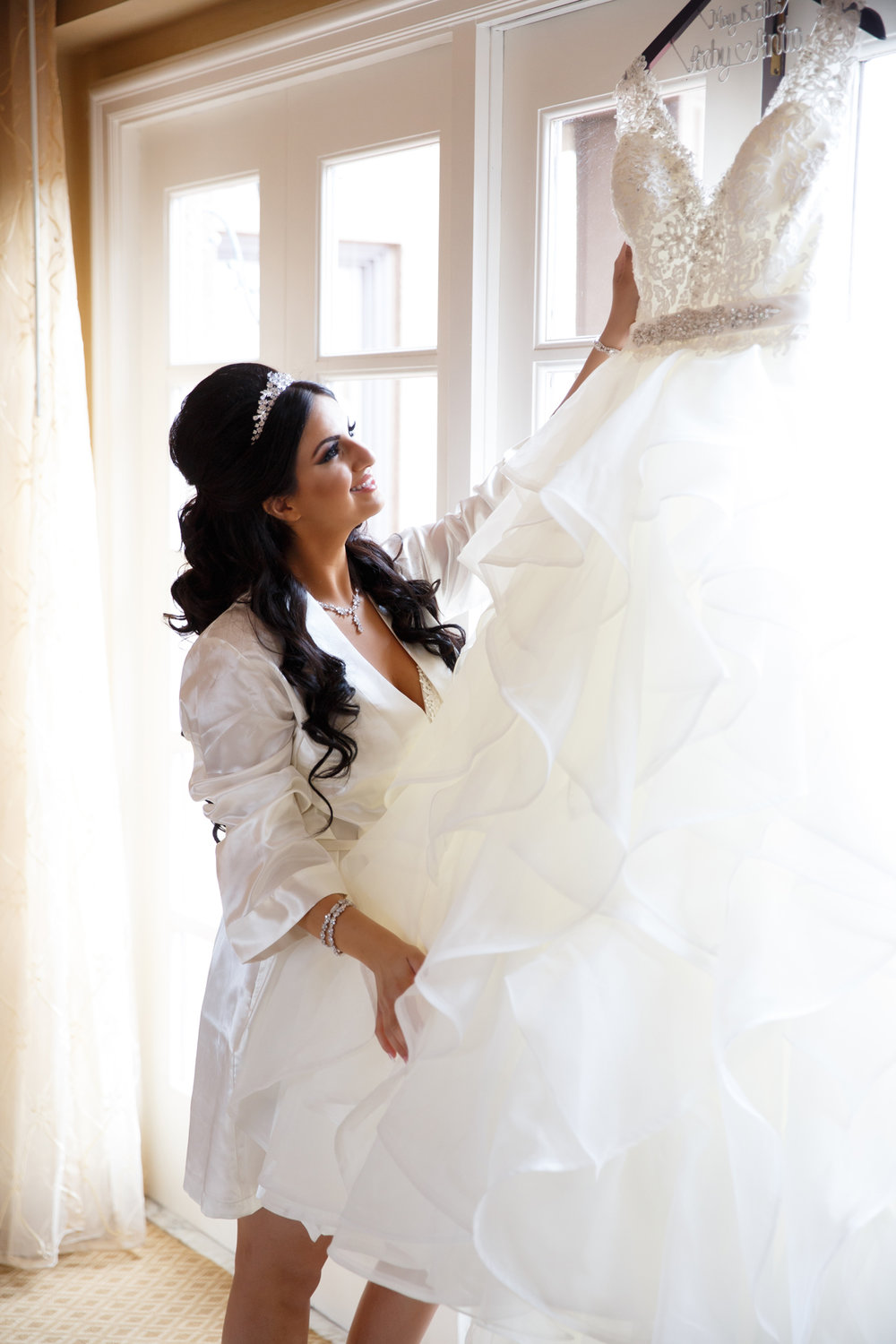 Elegant Pasadena Wedding to Make You Swoon bride admiring her gown.jpg