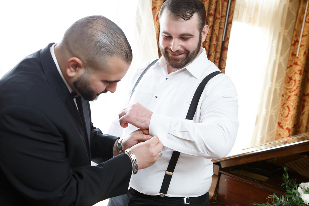 Elegant Pasadena Wedding to Make You Swoon groomsman helping groom with cufflinks_1.jpg