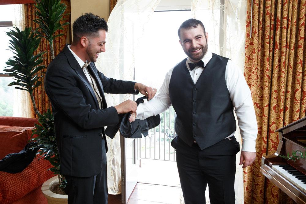 Elegant Pasadena Wedding to Make You Swoon best man helping groom.jpg