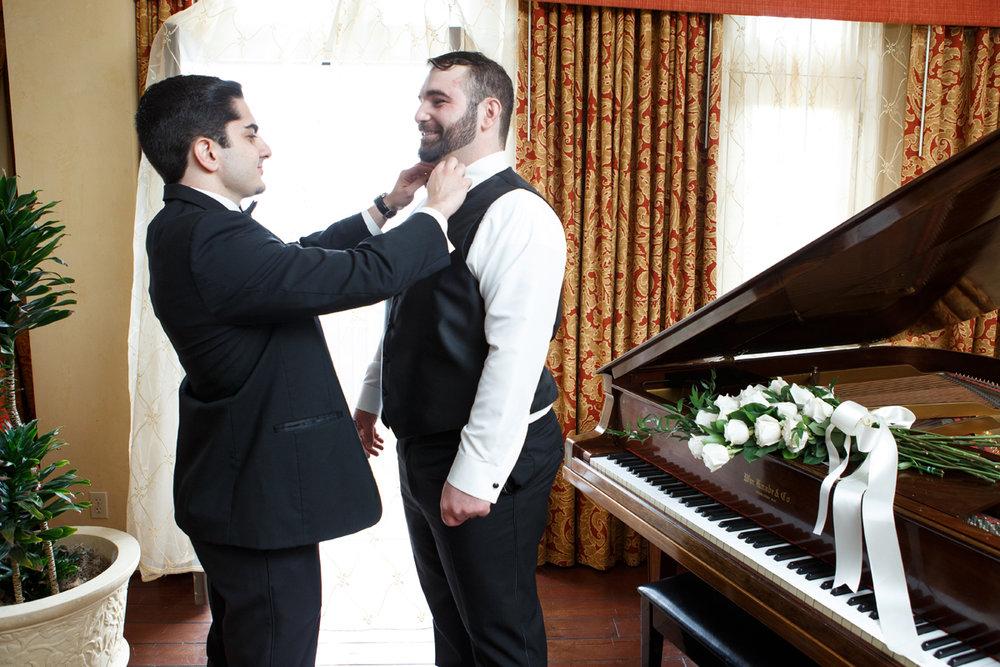 Elegant Pasadena Wedding to Make You Swoon groomsman helping groom with tie.jpg
