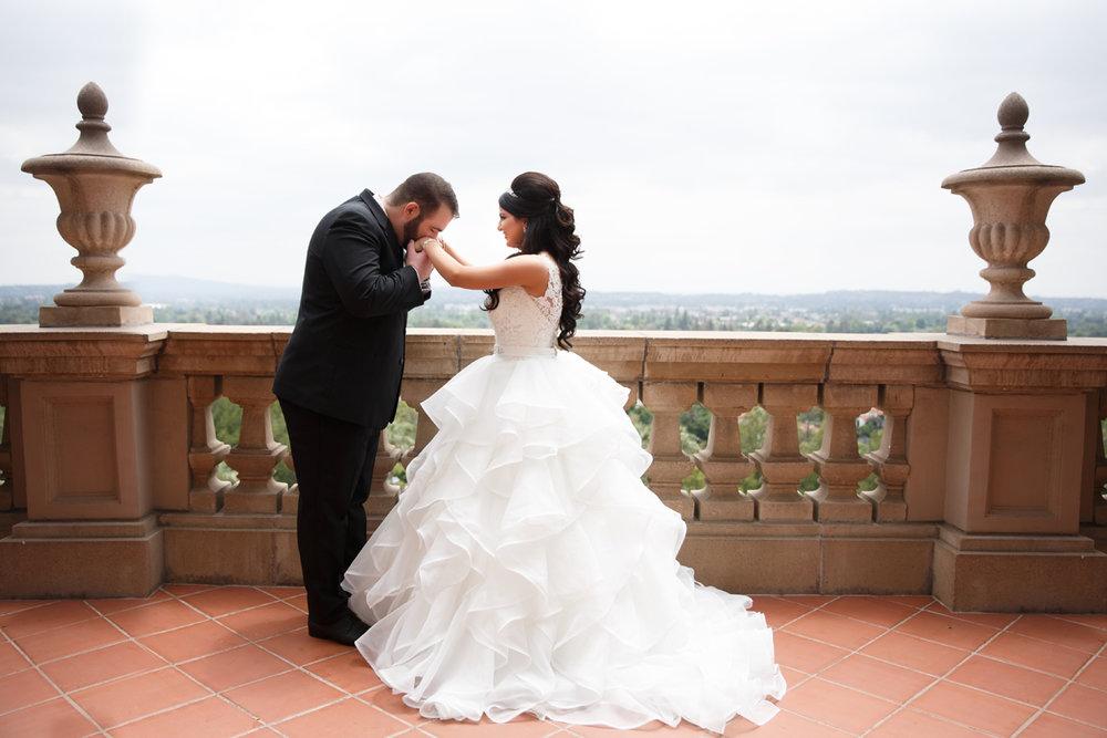Elegant Pasadena Wedding to Make You Swoon groom kissing brides hand after first look.jpg