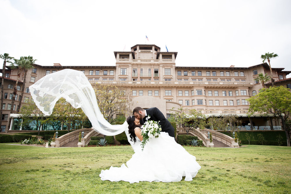 Elegant Pasadena Wedding to Make You Swoon bride and groom in front of the langham.jpg
