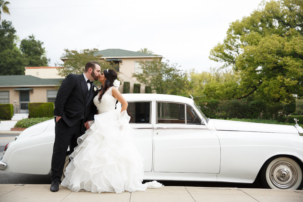 Elegant Pasadena Wedding to Make You Swoon bride and groom in front of classic limo.jpg