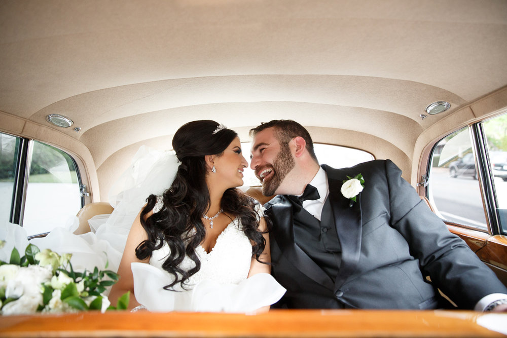 Elegant Pasadena Wedding to Make You Swoon bride and groom share happy moment in limo.jpg