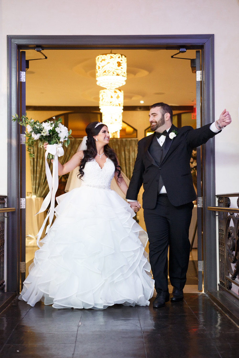 Elegant Pasadena Wedding to Make You Swoon bride and groom enter reception.jpg