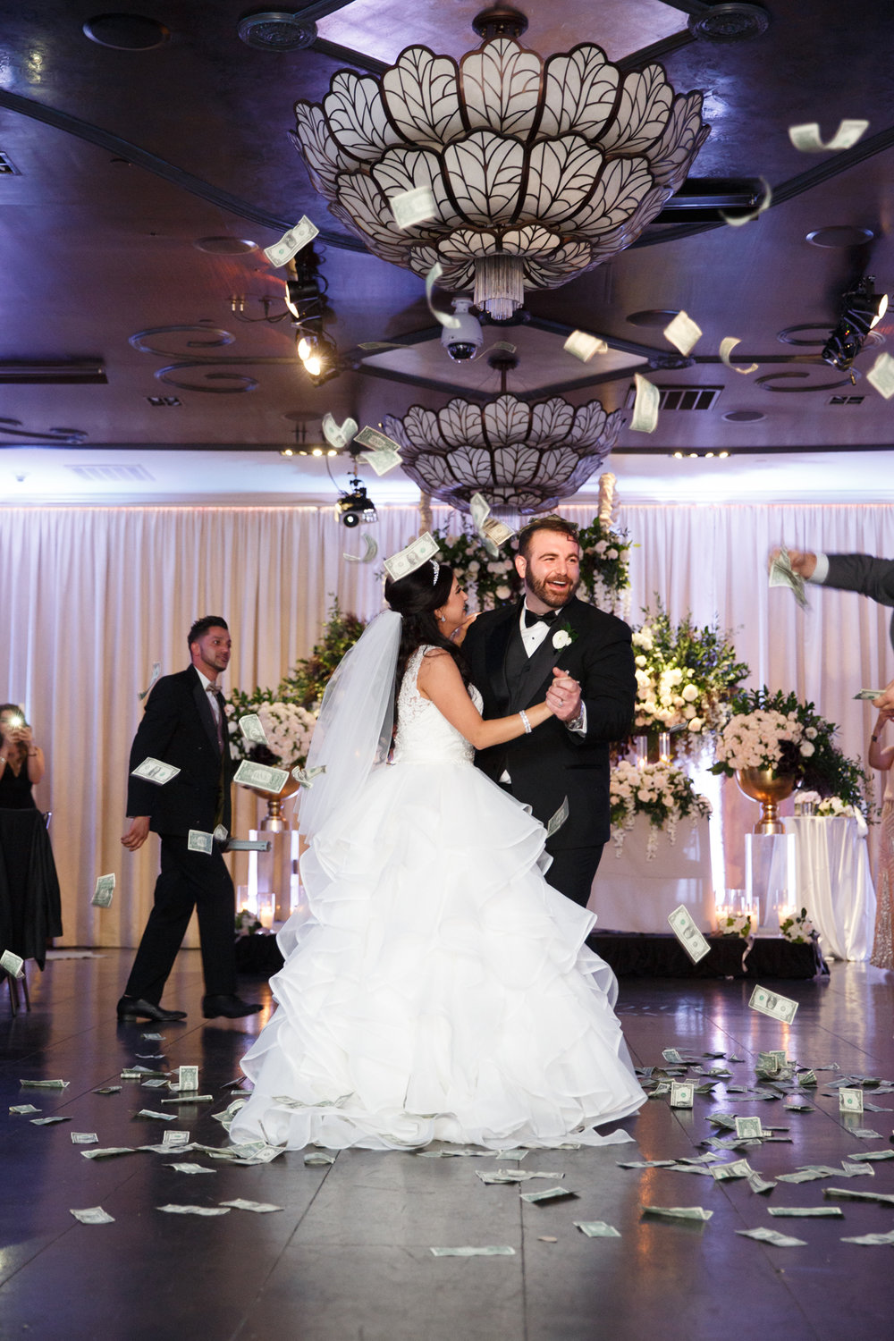 Elegant Pasadena Wedding to Make You Swoon cash flying.jpg