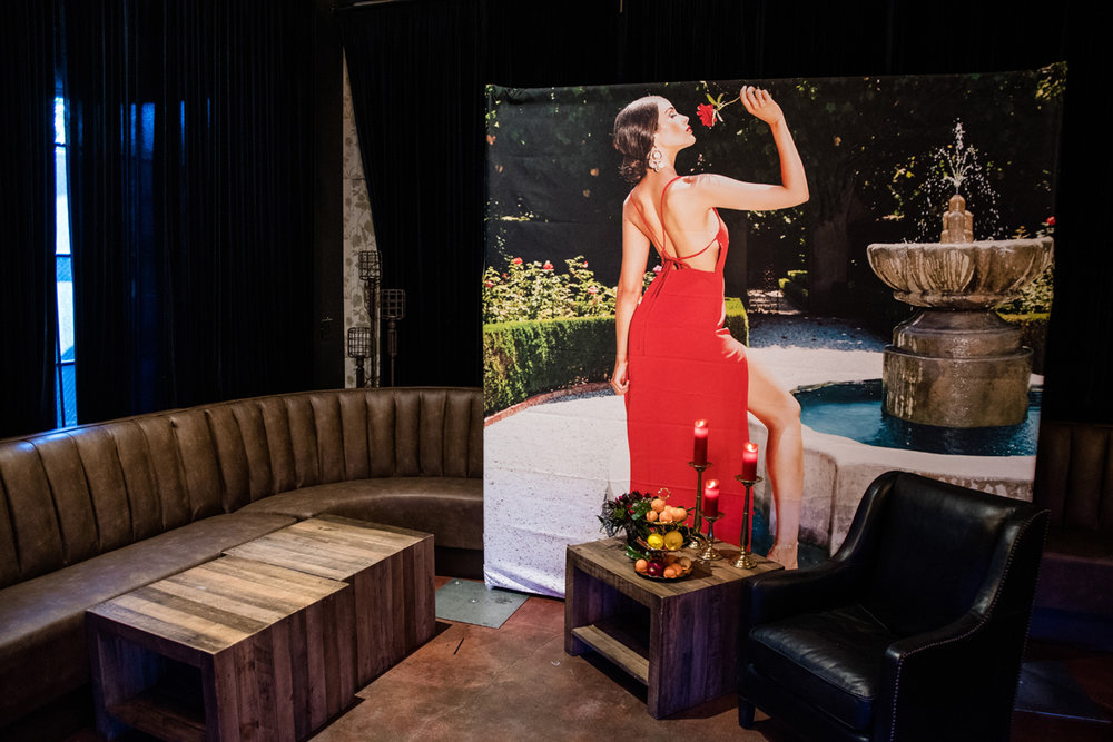 PrettyLittleThing PLT X Olivia Culpo Collection  Celebrity Launch Party large poster of Olivia in red gown.jpg