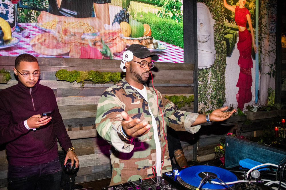 PrettyLittleThing PLT X Olivia Culpo Collection  Celebrity Launch Party DJ Taye James having fun.jpg