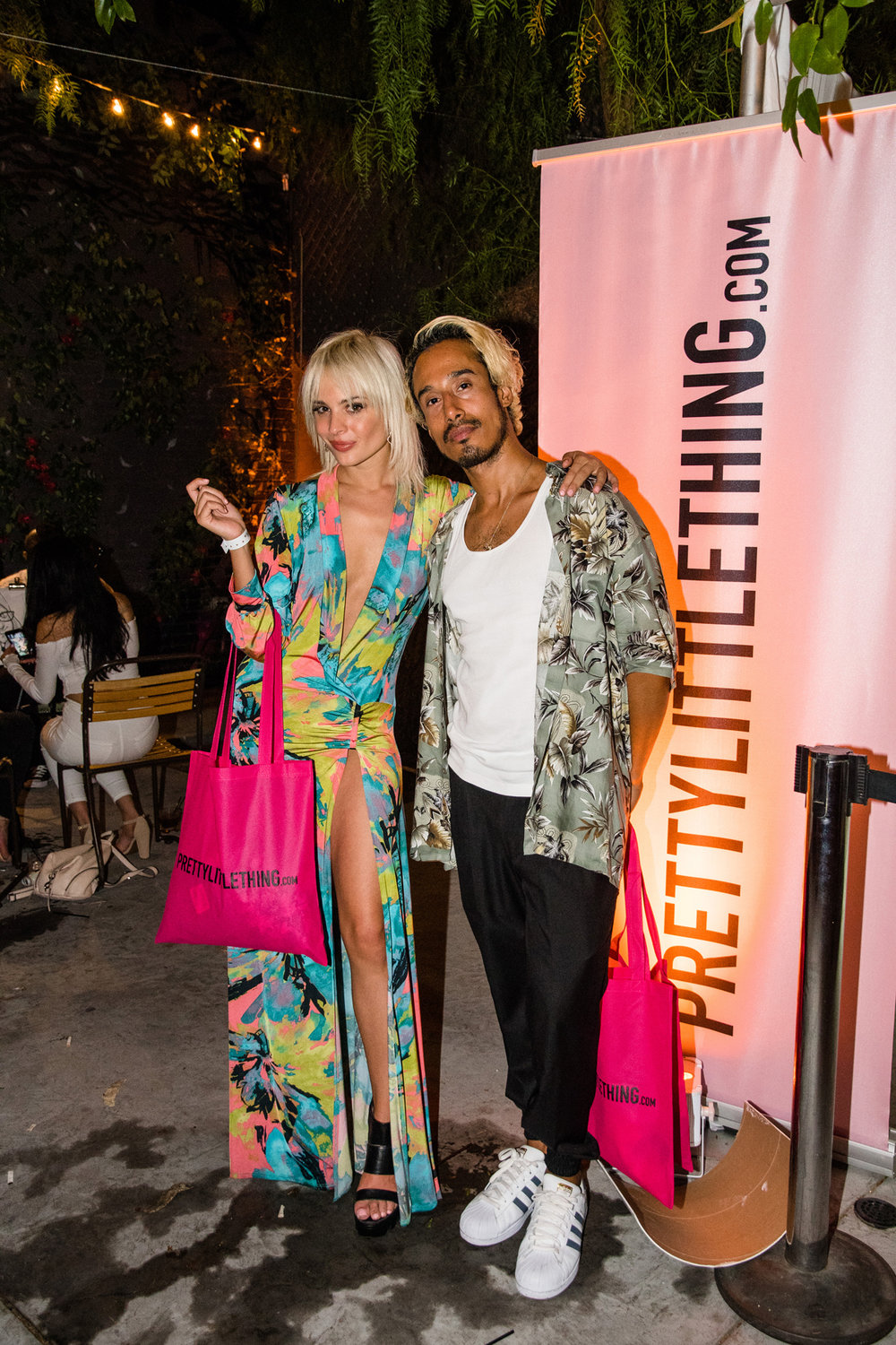 PrettyLittleThing PLT X Olivia Culpo Collection  Celebrity Launch Party party goers with their bag of goodies.jpg