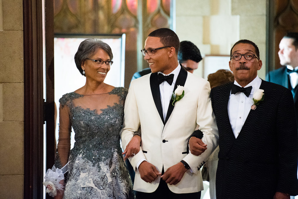 Dreamy Romantic Wedding at Historic Los Angeles Ebell Club parents walking groom down the aisle.jpg