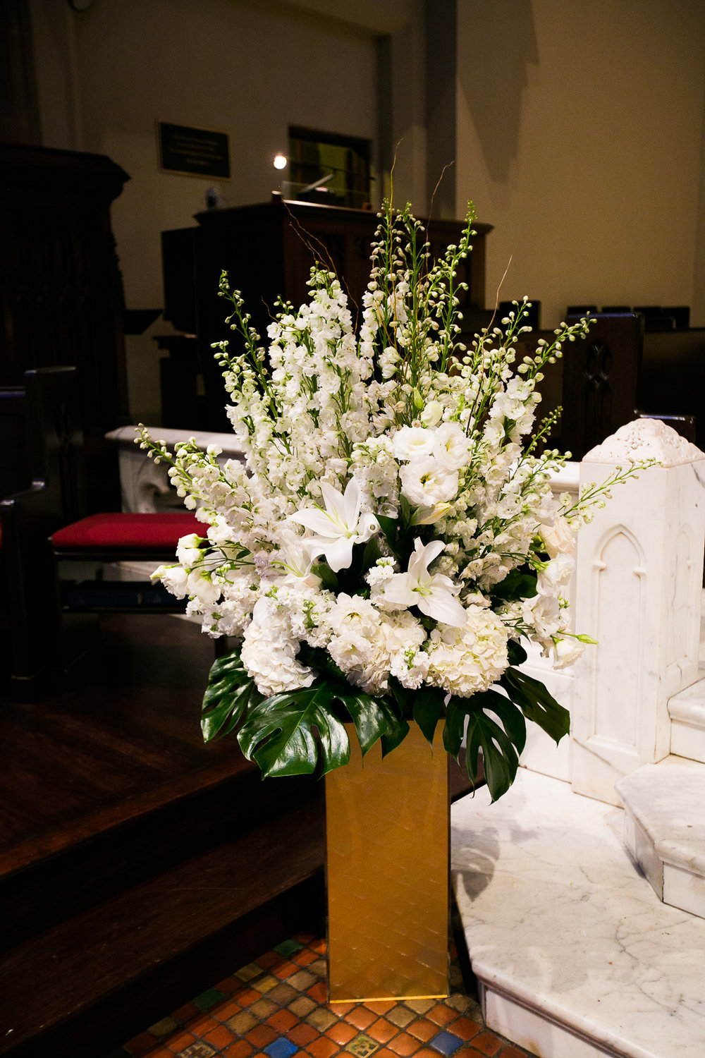 Dreamy Romantic Wedding at Historic Los Angeles Ebell Club floral spray at church.jpg