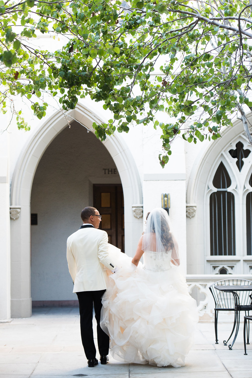 Dreamy Romantic Wedding at Historic Los Angeles Ebell Club bride and groom in courtyard of church.jpg