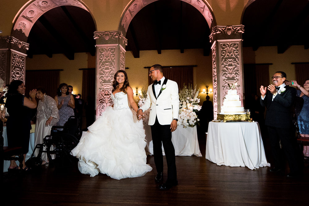 Dreamy Romantic Wedding at Historic Los Angeles Ebell Club bride and groom enter reception.jpg