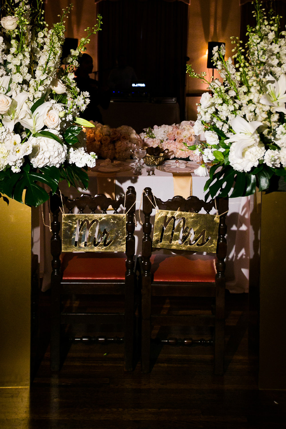Dreamy Romantic Wedding at Historic Los Angeles Ebell Club mr and mrs signs on chairs.jpg