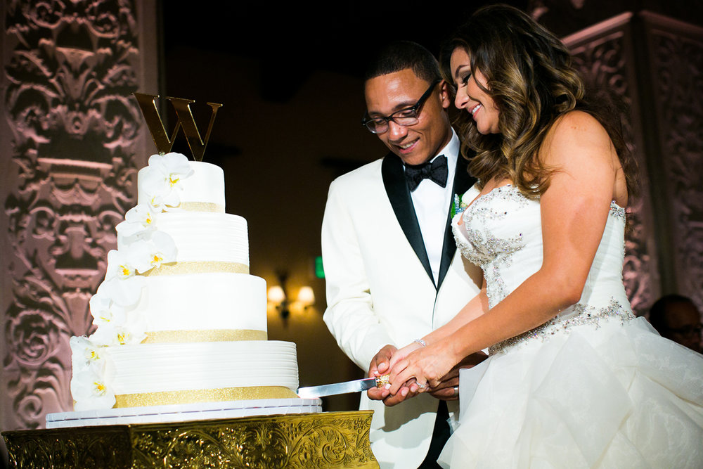 Dreamy Romantic Wedding at Historic Los Angeles Ebell Club cutting the cake.jpg