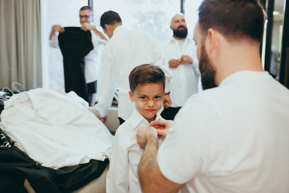 Breathtaking Contemporary Jewel Toned Fall Posh Wedding groom helping son.jpg