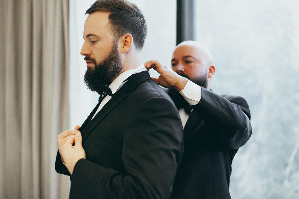 Breathtaking Contemporary Jewel Toned Fall Posh Wedding helping groom.jpg