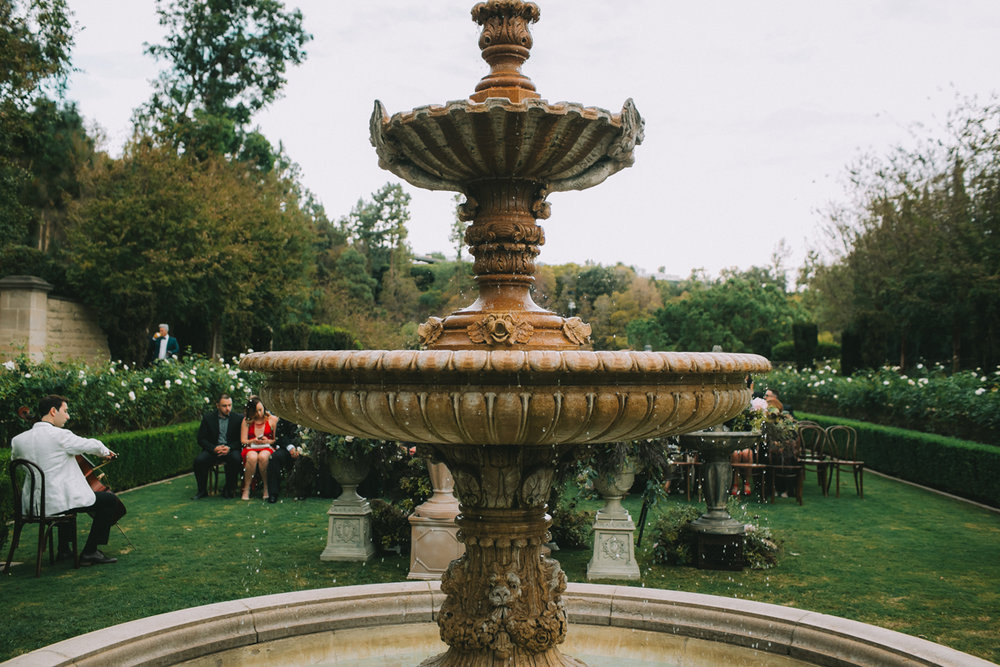 Breathtaking Contemporary Jewel Toned Fall Posh Wedding fountain at greystone mansion.jpg