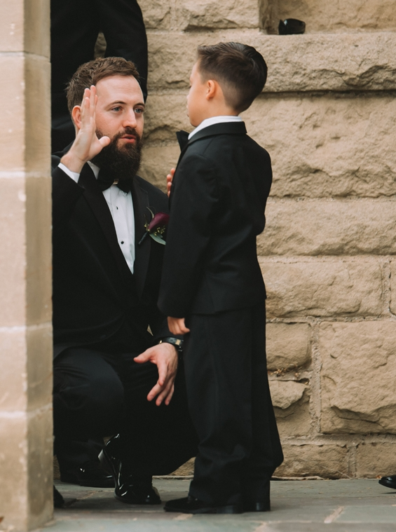 Breathtaking Contemporary Jewel Toned Fall Posh Wedding groom and his son getting ready for ceremony to start.jpg