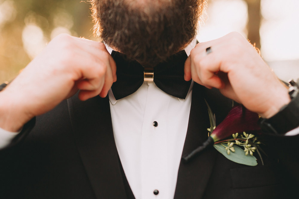 Breathtaking Contemporary Jewel Toned Fall Posh Wedding groom in bow tie.jpg