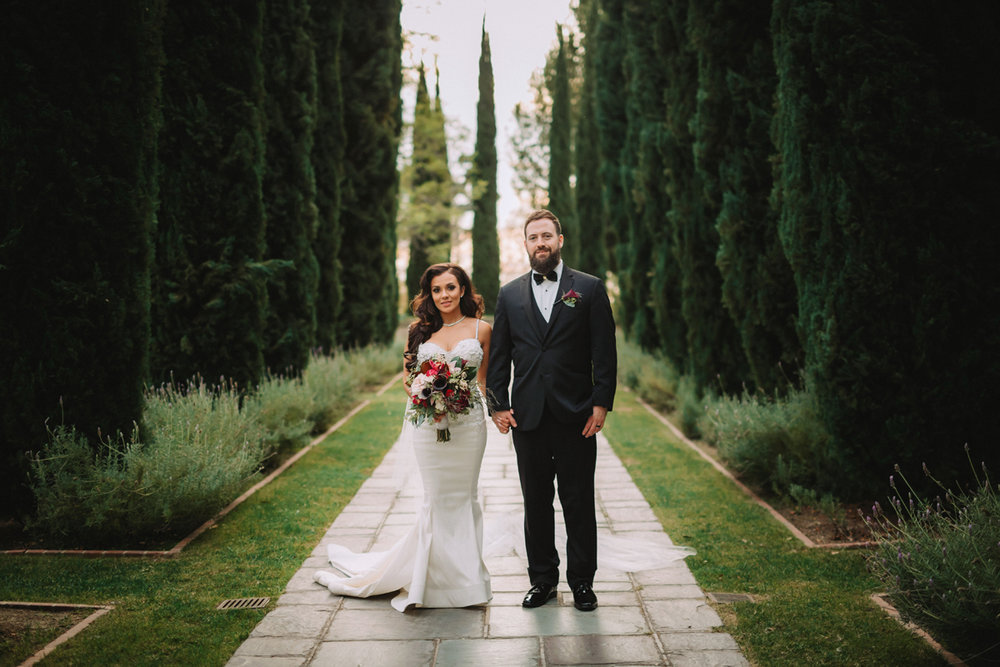 Breathtaking Contemporary Jewel Toned Fall Posh Wedding groom and bride in the gardens.jpg