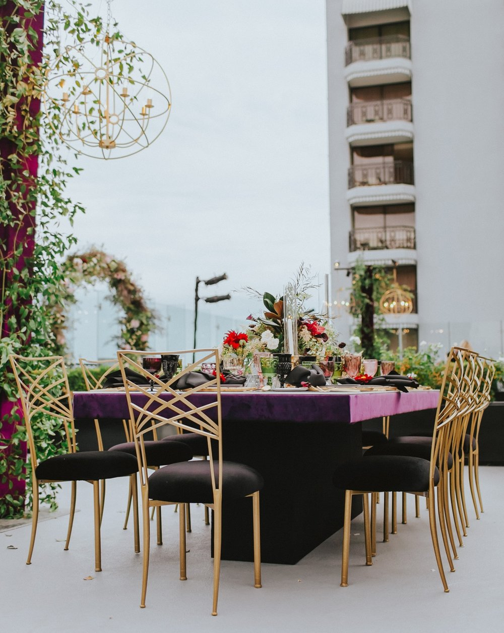 Breathtaking Contemporary Jewel Toned Fall Posh Wedding dinner space on roof.jpg