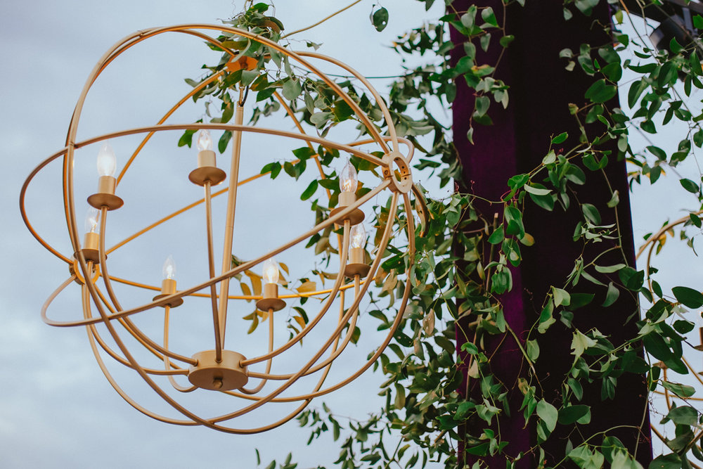 Breathtaking Contemporary Jewel Toned Fall Posh Wedding gold chandelier.jpg